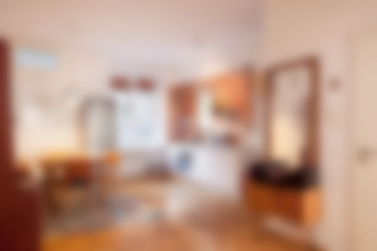 Living room by En Casa Premium Real Estate