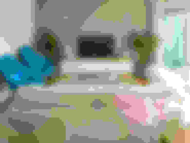 Salas de estilo  por MUDA Home Design