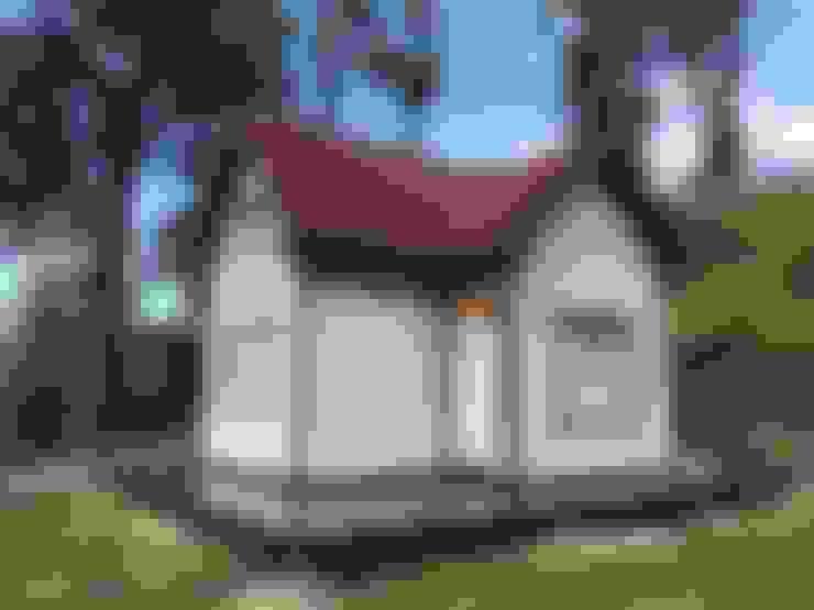 Casas de estilo  de 現代建材有限公司