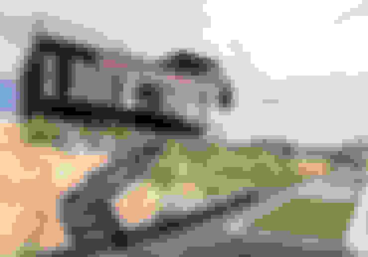 Giardino in stile  di B+V Arquitectos