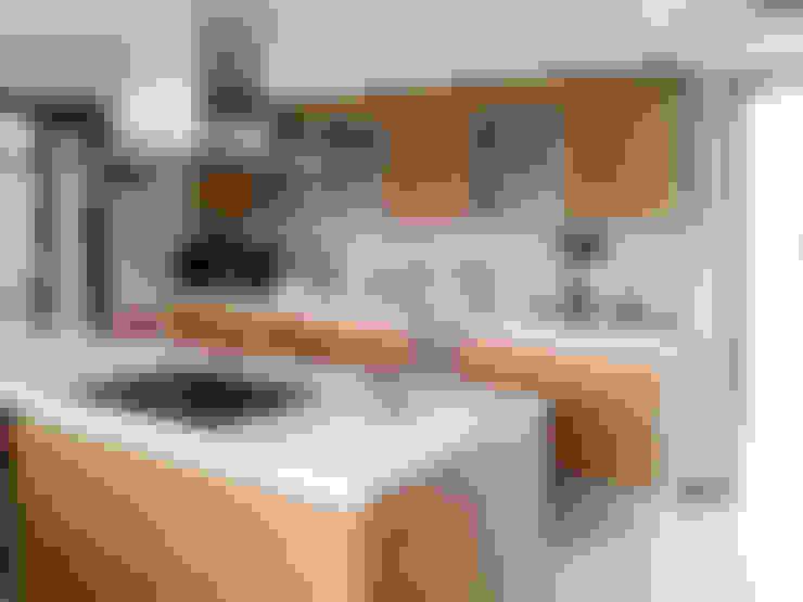 Casa en Rumencó: Cocinas de estilo  por id:arq