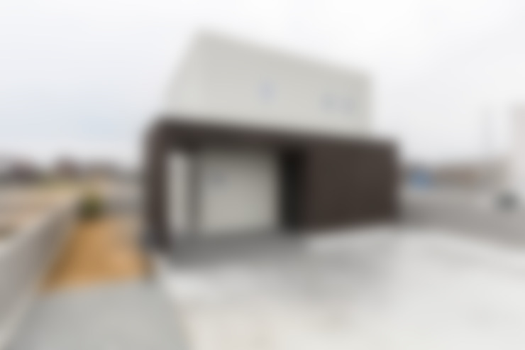 Casas unifamiliares de estilo  por KAWAZOE-ARCHITECTS