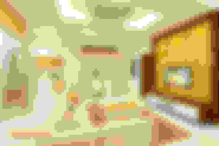 Living & Dining:  Living room by Kredenza Interior Studios