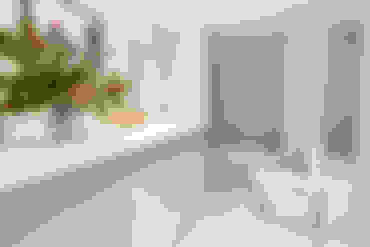 Salle de bains de style  par Pia Estudi