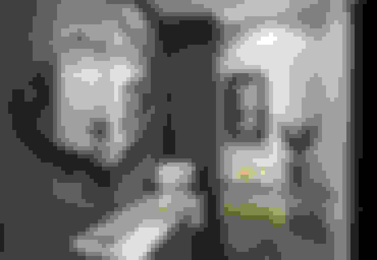 Cobertura Sion: Banheiros  por Andréa Buratto Arquitetura & Decoração