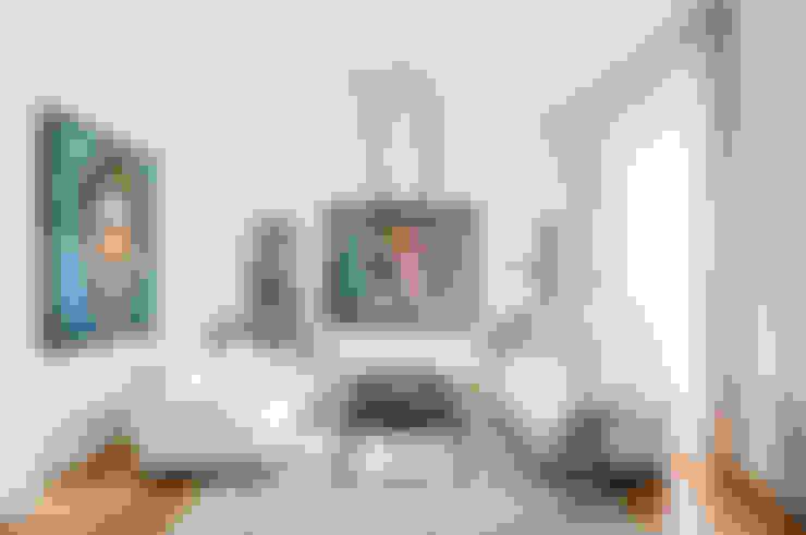 Living room by NOMADE ARCHITETTURA E INTERIOR DESIGN