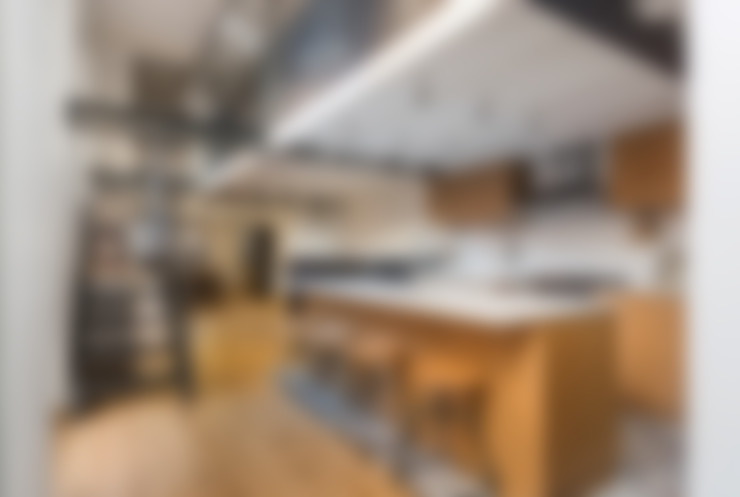 Kitchen by NOMADE ARCHITETTURA E INTERIOR DESIGN