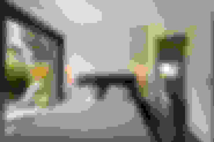 Dormitorios de estilo  por Atelier Jean GOUZY