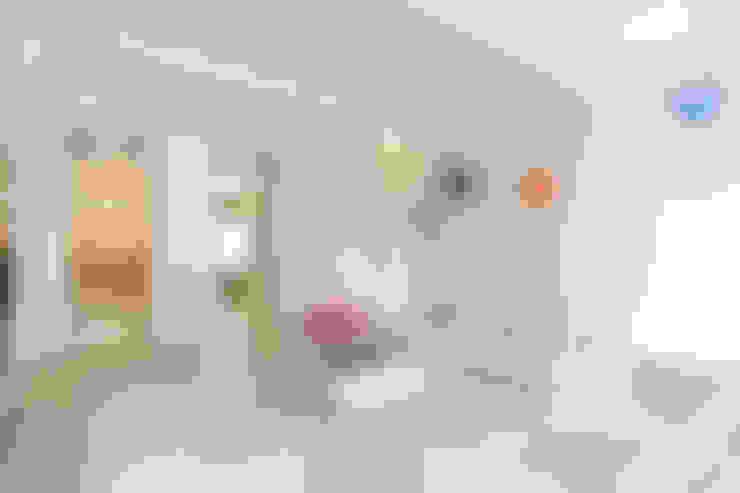 Living room by studio di architettura DISEGNO