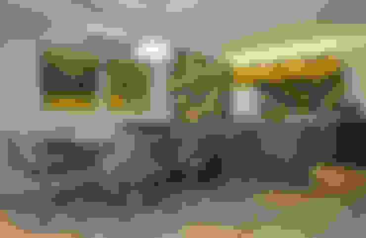 Dining room by Karinna Buchalla Interiores