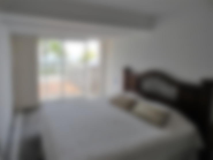 Apartamento de Playa: Cuartos de estilo  por RRA Arquitectura