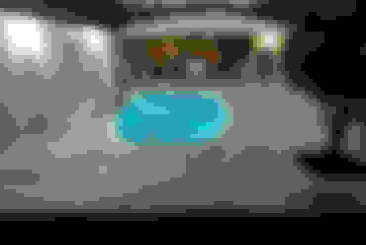 Piscina mediana´para casas campestres y fincas : Piscinas de estilo  por IGUI FIBRAPISCINAS