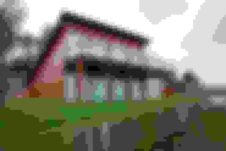 Casa di legno in stile  di Rusticasa