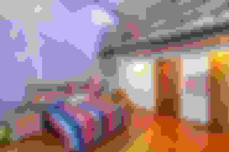 Dormitorios de estilo  por SANTIAGO PARDO ARQUITECTO