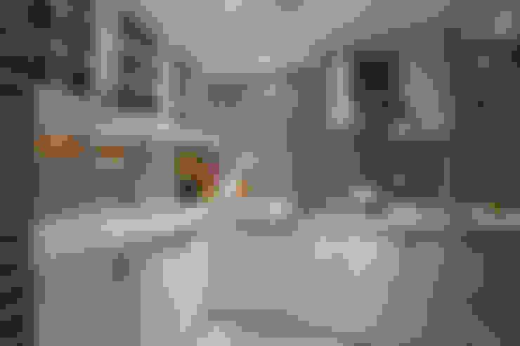 Cocinas de estilo  de 哲嘉室內規劃設計有限公司