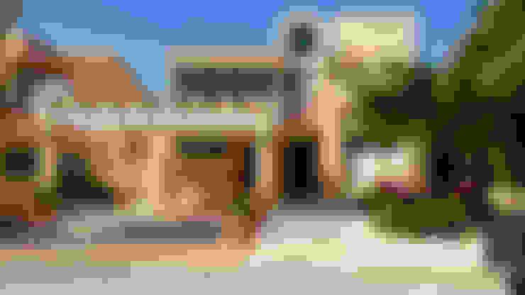 Casas unifamiliares de estilo  por DHI Arquitectos y Constructores de la Riviera Maya