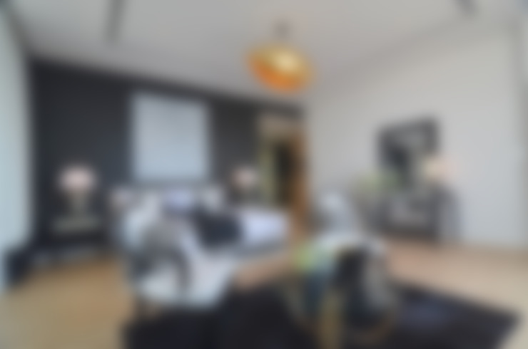 Camera da letto in stile  di Etcetera Living