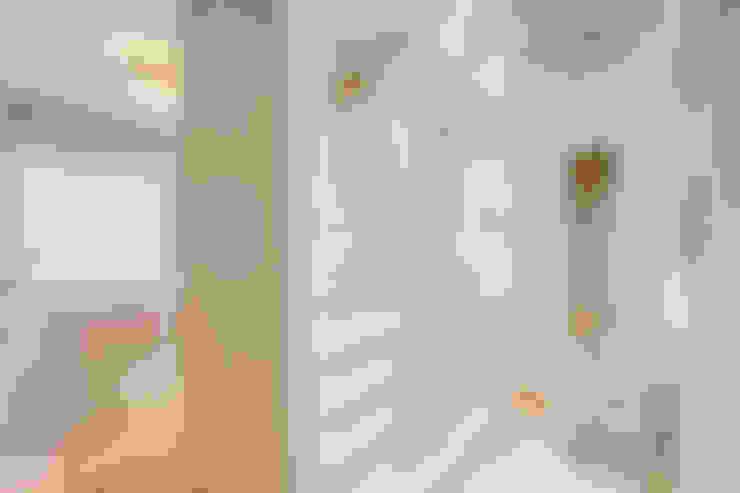 Walk in closet de estilo  por Santiago | Interior Design Studio