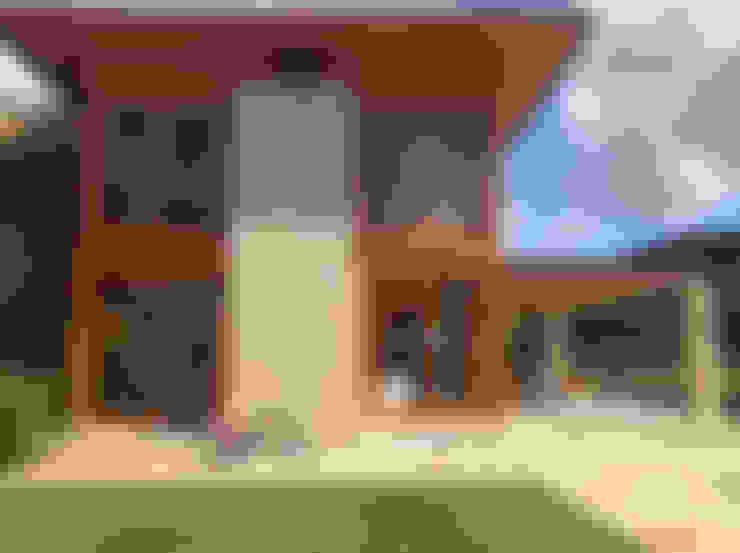 FACHADA: Casas do campo e fazendas  por Maria Claudia Faro