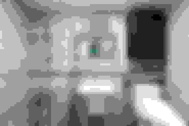 Baños de estilo  por 한디자인 / HAN DESIGN