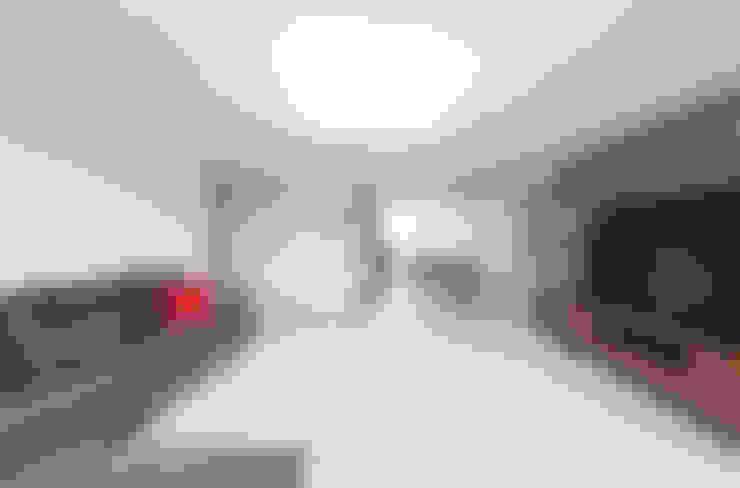 Salas de estilo  por 한디자인 / HAN DESIGN