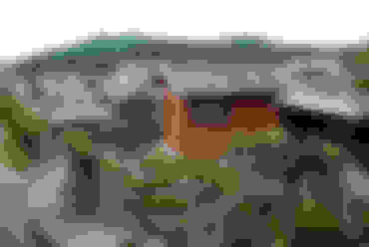 Casas de estilo  de 丸菱建築計画事務所 MALUBISHI ARCHITECTS