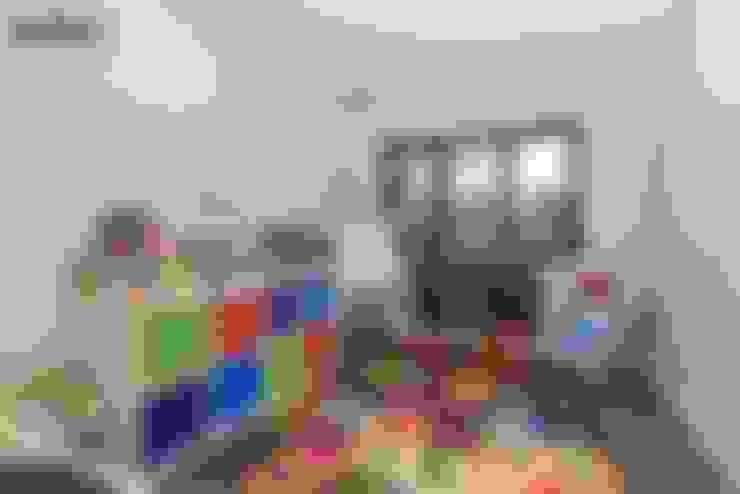 Nursery/kid's room by The Market Design & Build