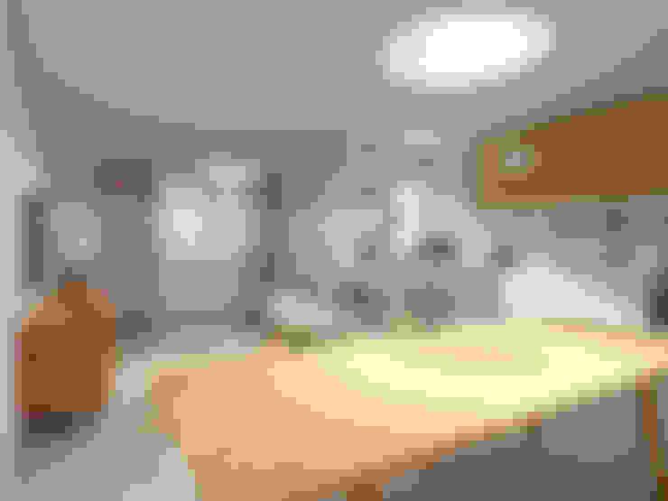 Casa do Zé e da Vanda: Salas de jantar  por Homestories