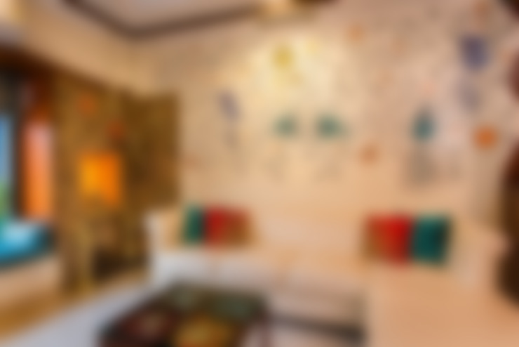 Chembur Renovation:  Living room by Rennovate Home Solutions pvt ltd