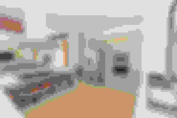 casa de campo calima : Cocinas integrales de estilo  por astratto