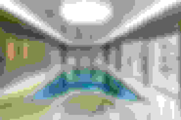 Piscinas desbordantes de estilo  por London Swimming Pool Company