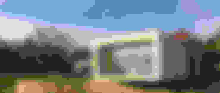 Casa do Penedo: Casas unifamilares  por Eurico Soares Teixeira Arquiteto - Unipessoal, Lda