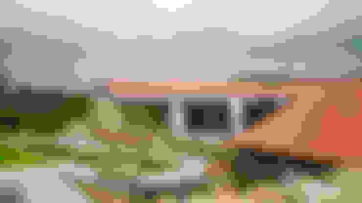 Casas unifamiliares de estilo  por Eurico Soares Teixeira Arquiteto - Unipessoal, Lda