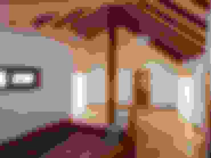 Vista Living Comedor: Livings de estilo  por Nomade Arquitectura y Construcción spa