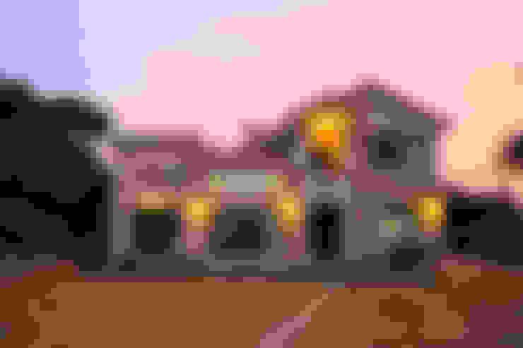 남유럽풍 전원주택: (주)디엘건축의  주택