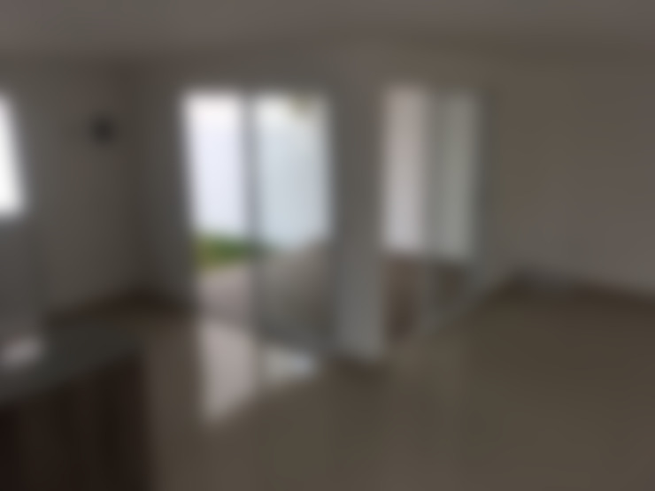Salas / recibidores de estilo  por Integra Arquitectos