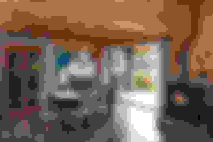Comedores de estilo  por Patagonia Log Homes - Arquitectos - Neuquén