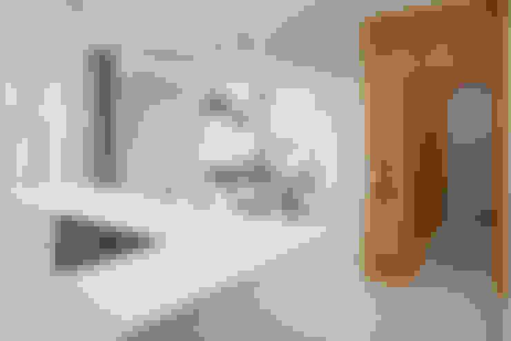 Livings de estilo  por manuarino architettura design comunicazione
