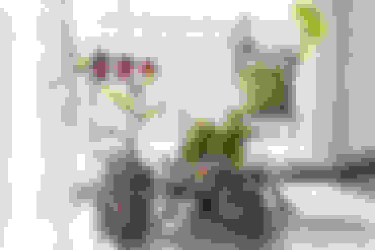 내추럴한 감성이 담긴 부천 아파트 인테리어 : 이즈홈의  베란다