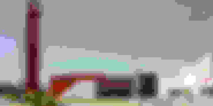 Fachada lateral: Centros Comerciales de estilo  por Helicoide Estudio de Arquitectura