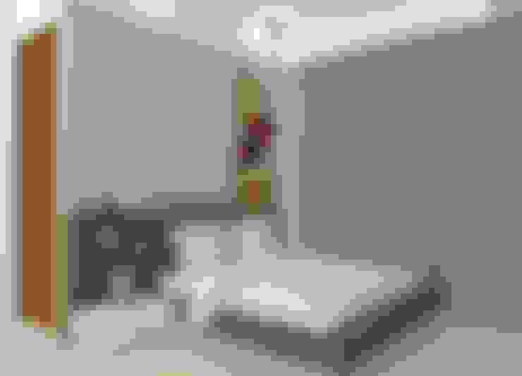 Dormitorios de estilo  de Midas Dezign