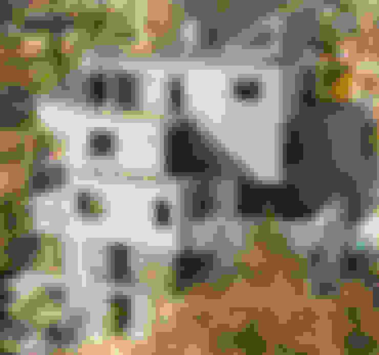 Edificio con Fachada transventilada: Casas de estilo  por INFINISKI