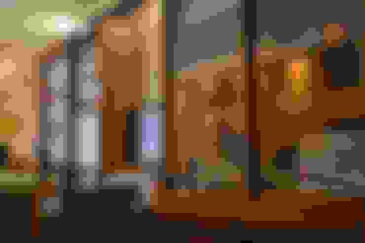 Interiores de escritório: Espaços comerciais  por 5CINQUE ARQUITETURA LTDA