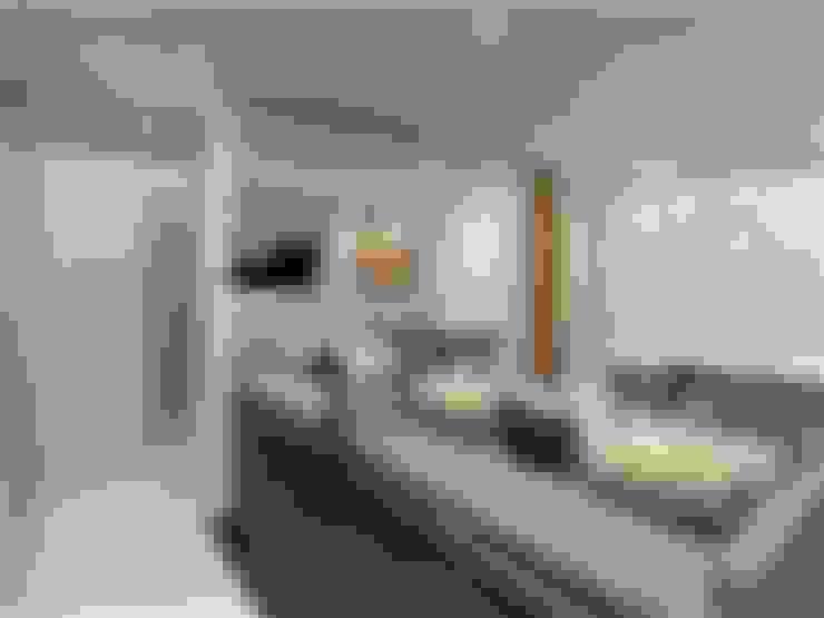 Sala de estar integrada : Salas de estar  por Vilaville