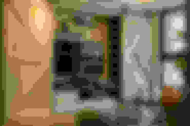 Living room by 富亞室內裝修設計工程有限公司