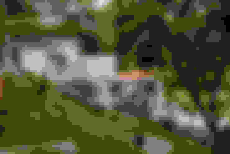 Jardines en la fachada de estilo  por GRUPO WALL ARQUITECTURA Y DISEÑO SA DE CV