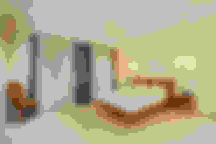 Dormitorios de estilo  por BK Design Studio