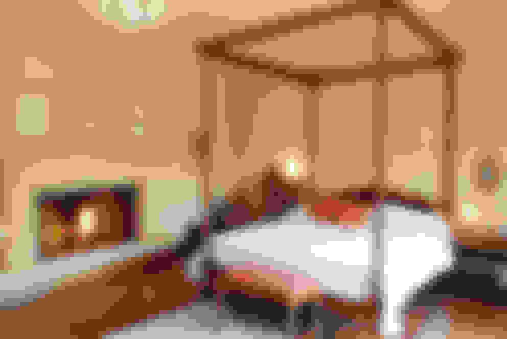 Casa Martindale: Dormitorios de estilo  por JUNOR ARQUITECTOS