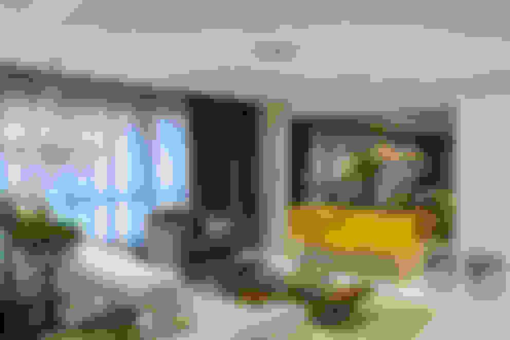 Livings de estilo  por Michele Moncks Arquitetura