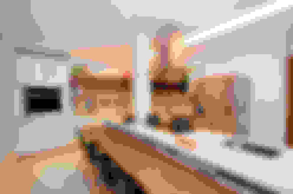 Cozinha Gourmet: Cozinhas  por Adoro Arquitetura
